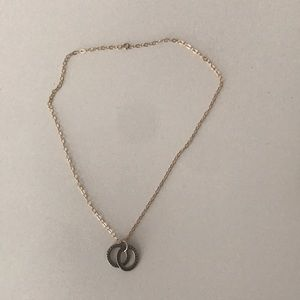 Necklace with gold and silver colored oval design
